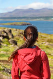 Hiking woman in hardshell jacket in Iceland nature Stock Photo