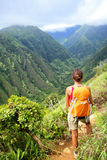 Hiking woman on Hawaii, Waihee ridge trail, Maui. USA. Young female hiker walking in beautiful lush Hawaiian forest nature landscape in mountains. Asian woman Stock Image