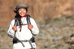 Hiking - woman hiker. Walking outdoors in mountain landscape smiling happy looking at copy space. Multiracial Asian Caucasian female model outdoors Royalty Free Stock Images