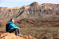 Hiking - woman hiker enjoying view. Woman sitting looking over beautiful volcano mountain landscape. From volcano Teide, Tenerife, Canary Islands, Spain Royalty Free Stock Photography