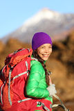 Hiking woman hiker living healthy lifestyle. Hiking outdoors wearing backpack smiling happy. Beautiful female trekking with looking with aspirations. Mixed race stock image