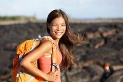 Hiking woman - hiker walking on lava field Hawaii. Hiking woman - hiker walking on lava field on Hawaii. Tourist on hike near Kilauea volcano around Hawaii Royalty Free Stock Image