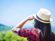 Hiking woman looking at inspirational mountains landscape. Fitness and healthy lifestyle outdoors in colorful summer nature. Trekking, camping and climbing royalty free stock photography