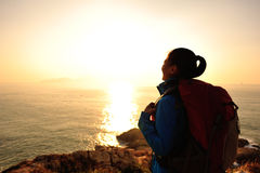 Hiking woman looking sunrise Royalty Free Stock Photos