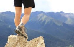 Hiking woman on mountain peak Stock Photography