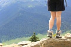 Hiking woman on mountain peak Royalty Free Stock Photo