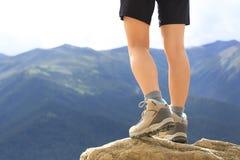 Hiking woman on mountain peak Stock Photo