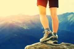 Hiking woman on mountain peak Royalty Free Stock Image