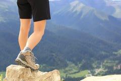 Hiking woman on mountain peak Stock Image