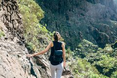 Hiking woman in the mountains. Masca valley, Tenerife, Canary islands, Spain. Active vacation concept Stock Photography
