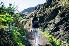 Hiking woman in the mountains. Masca valley, Tenerife, Canary islands, Spain. Active vacation concept Royalty Free Stock Image