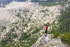 Hiking woman in mountains Royalty Free Stock Images