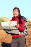 Hiking woman in nature holding map. Outdoors in nature. Smiling happy hiker in desert mountain landscape Stock Photos