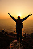 Hiking woman open arms to sunrise Royalty Free Stock Image