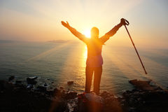 Hiking woman open arms to the sunrise Royalty Free Stock Images