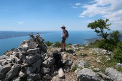 Hiking woman overlooking Adriatic see royalty free stock photo