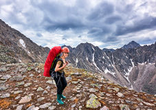 Hiking. Woman on pass Royalty Free Stock Photography