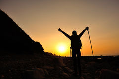 Hiking woman raised arms to sunrise Royalty Free Stock Photo