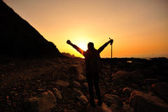 Hiking woman raised arms to sunrise Royalty Free Stock Photography