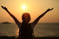 Hiking woman raised arms to sunrise Stock Photography