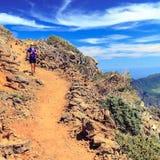 Hiking woman, runner hiker in summer mountains Stock Photos