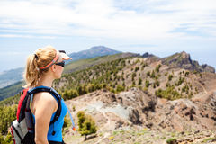 Hiking woman, runner in summer mountains Stock Photos