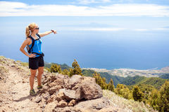 Hiking woman, runner in summer mountains Stock Photo
