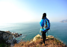 Hiking woman seaside Royalty Free Stock Image