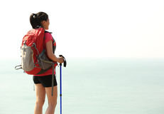 Hiking woman seaside Royalty Free Stock Images