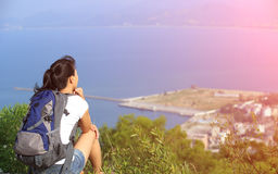 Hiking woman sit seaside Stock Photos