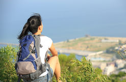 Hiking woman sit seaside. And looking the beautiful view Stock Photography