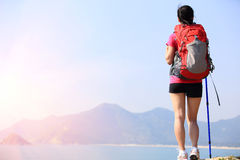 Hiking woman stand seaside Stock Photo