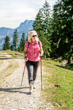 Hiking woman with sunglasses Stock Photos