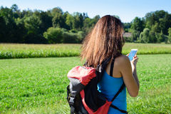 Hiking woman take photos with her smart phone Stock Photo