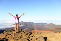 Hiking woman on top happy and celebrating success royalty free stock photo