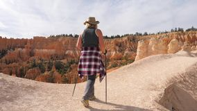 Woman Hiking On A Scenic Footpath Trail In Bryce Canyon Park. Hiking woman tourist in Bryce Canyon National Park. Goes along footpath from where you can see stock video footage