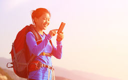 Hiking woman use smart phone taking photo Stock Photography