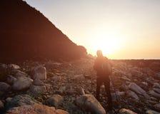 Hiking woman walking to sunrise Stock Photos