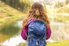 Hiking woman watching the lake view in Switzerland Royalty Free Stock Image
