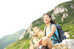 Hiking woman woman hiker sit on seaside mountain r Stock Photography