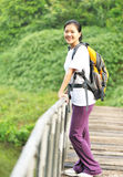 Hiking woman on wooden bridge Stock Image