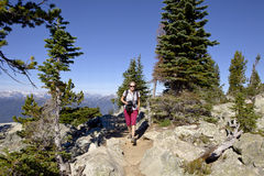 Hiking women with camera Royalty Free Stock Images