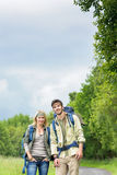 Hiking young couple backpack road Stock Photo