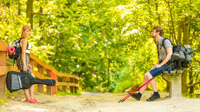 Hiking young couple with guitar backpack outdoor Royalty Free Stock Photos