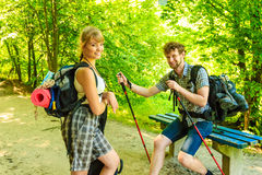 Hiking young couple with guitar backpack outdoor Stock Photo