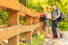 Hiking young couple with guitar backpack outdoor Royalty Free Stock Photography