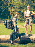 Hiking young couple with guitar backpack outdoor Stock Photography