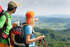 Hiking young couple point at panoramic view Royalty Free Stock Images