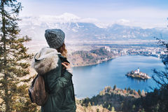 Hiking young woman with alps mountains and alpine lake on backgr. Ound. Travel Slovenia, Europe. Top view on Island with Catholic Church in Bled Lake with Castle Royalty Free Stock Photography