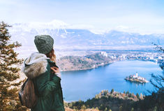 Hiking young woman with alps mountains and alpine lake on backgr Royalty Free Stock Photography